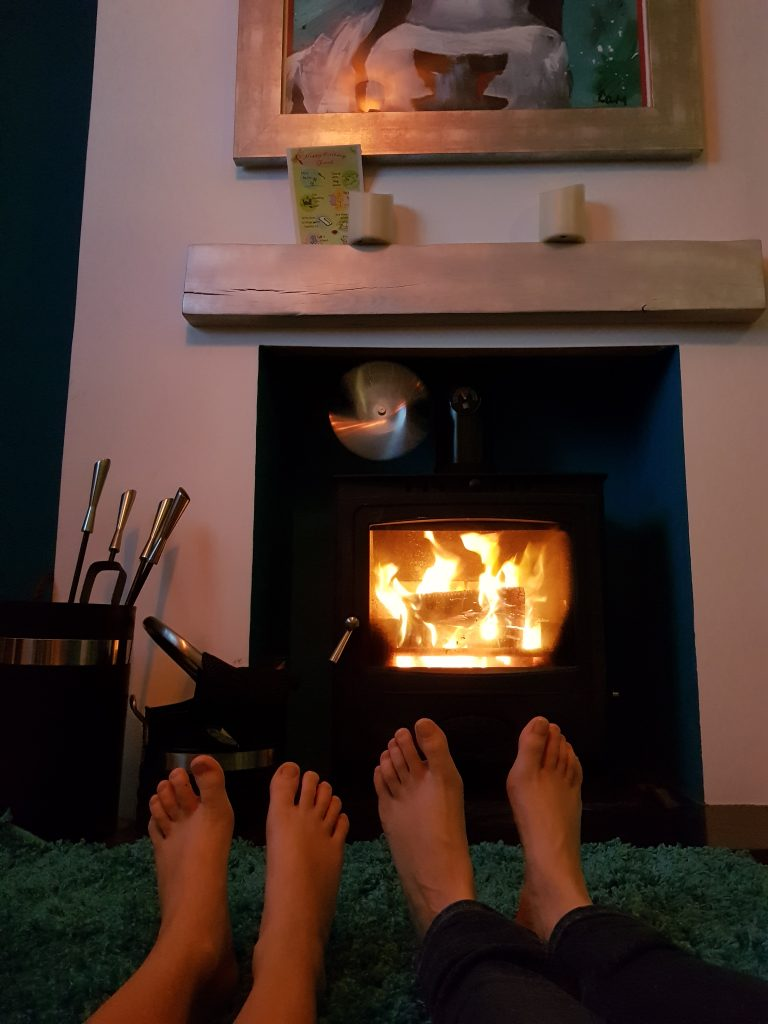 Toes warming by a woodburner